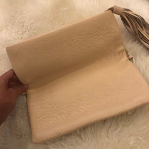 Peach colored GiGi clutch